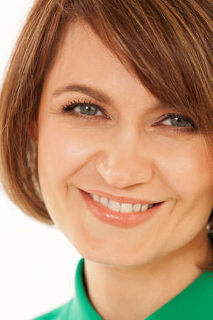 green clothes: Happy smiling adult brunette in close-up in green clothes