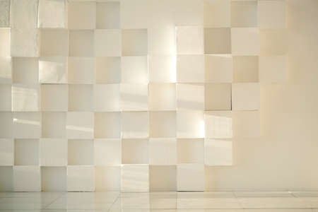 tiled wall: Close-up of white painted concrete modern wall made of cubes with tiled floor