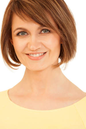 jovial: Attractive adult woman with short hair smiling at camera. Studio shot.