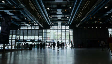 tec: Crowds of travelers moving through the vast corridors of the Georges Pompidou Centre