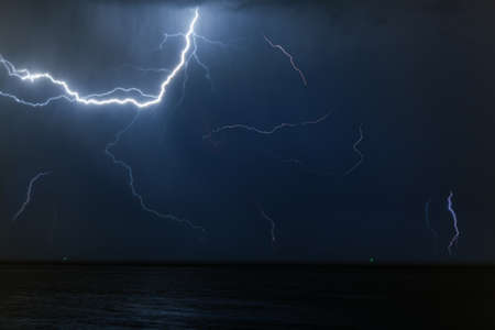 streak lightning: Bolt of lightening in a night sky during a thunderstorm with copy space in a weather or meteorology concept
