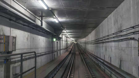 railroads: Subway rails in tunnel with wires on cement walls