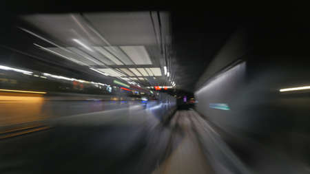 tunnel view: View on reflection of subway tunnel in moving trains window. Blur Stock Photo