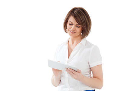 white blouse: Smiling adult woman with short hair in white blouse typing on pad. Isolated