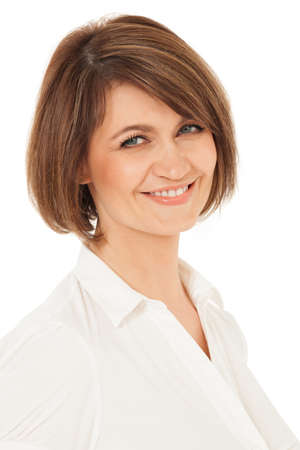white blouse: Attractive smiling woman in white blouse looking at camera. White background, studio shot. Stock Photo