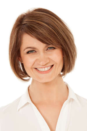 pretty brunette woman: Headshot of adult woman looking at camera with toothy smile. Isolated, studio shot. Stock Photo