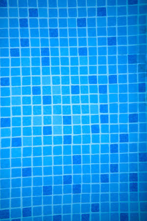 floor covering: Background texture and pattern of colorful bright blue mosaic tiles in a full frame view covering a wall or floor Stock Photo
