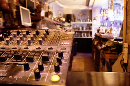 control center: Music control center or deck in a retail store with sound, amplifier and mixing knobs for broadcasting to entertain customers