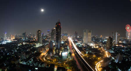 city view: Night cityscape of Bangkok, the capital of Thailand. Modern urban architecture, transport traffic and illuminated streets