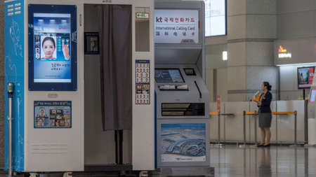 incheon: SEOUL, SOUTH KOREA - OCTOBER 22, 2015: International Calling Card machine next to photo booth in the airport of Incheon