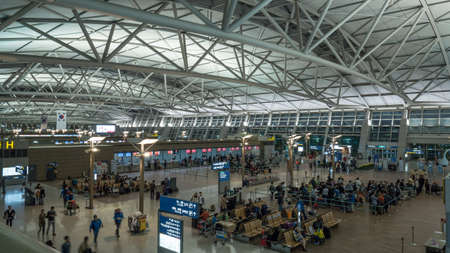 incheon: SEOUL, SOUTH KOREA - OCTOBER 22, 2015: Big hall with people in waiting areas. Incheon International Airport is the primary one serving the Seoul Capital Area, and it is of the largest and busiest airports in the world