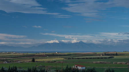 olympus: Nature scene with farmlands, green plantations and Olympus Mountain in the distance. Greece, Kalikratia Stock Photo