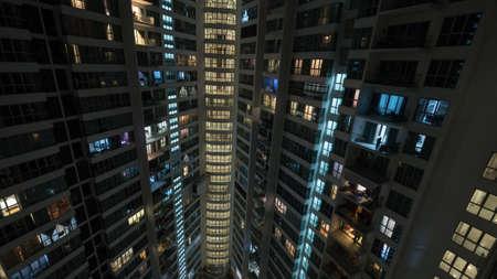 apartment block: Lights in the windows of high-rise apartment block at night. Kuala Lumpur, Malaysia Stock Photo