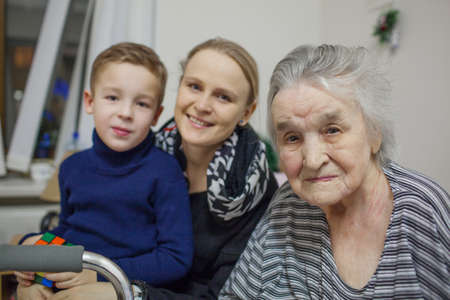 An everyday portrait of a young woman, her son and her grandmother Imagens