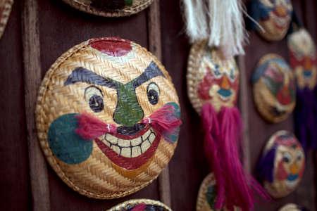 Souvenir masks at a Hanoi marketplace close up Фото со стока