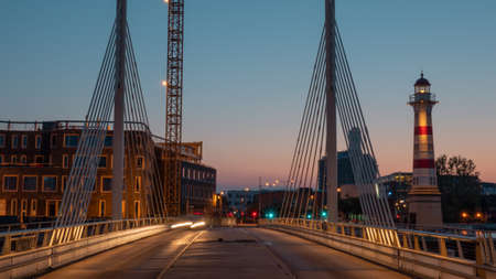 An evening landscape of Malmo - with bridge constructions and a lighthouse 스톡 콘텐츠