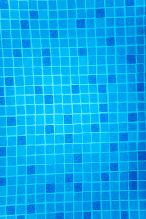 A fragment of blue pool tile, slightly distorted by invisible water
