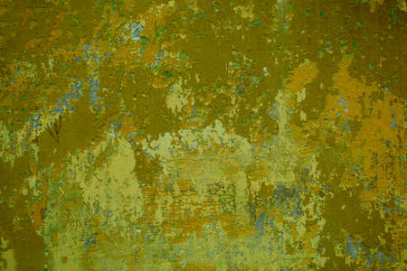 Grungy cement wall with cracks and old dingy green paint remnants in a full frame view. This is a lighter version, a darker version is also available in the portfolio Imagens