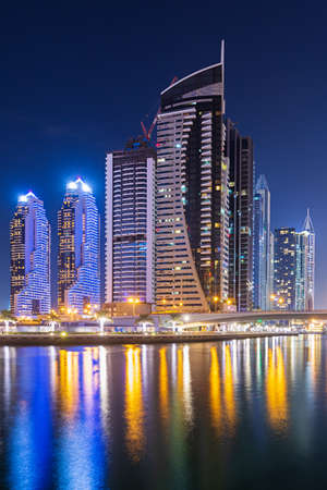 Dubai Marina, UAE - 12 November 2018: Dubai Marina at night with view of the promenade and city of artificial channel length of 3 kilometers of Persian Gulf shoreline.