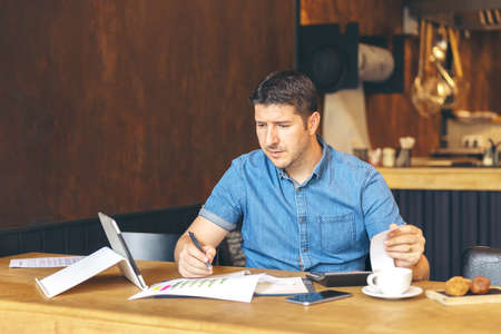Stressed new small business owner calculating online restaurant taxes and expenses due to isolation quarantine and global crisis