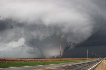 Massive terrifying tornado scours the farmland in Illinois. Stock Photo