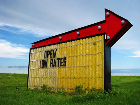 An RV park sign in South Dakota points to the nearest prairie oasis for campers.