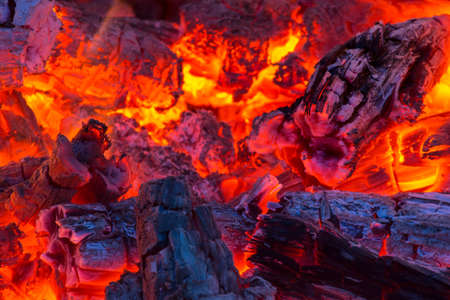 Scalding hot embers radiate an orange glow.