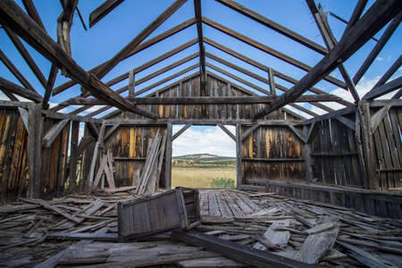 The ruins of a wooden building on the great plains, seen from the inside. Stock Photo
