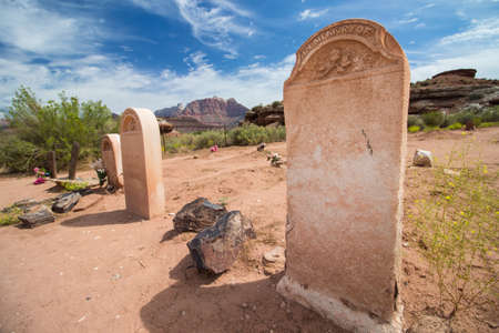 Blank gravestones in the cemetery of a desert ghost town.