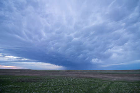 Mammatus clouds stretch across the sky in the Great Plains.