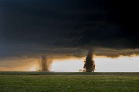Two tornadoes touch down simultaneously in the plains of eastern Colorado, a rare and spectacular weather event. Stock Photo