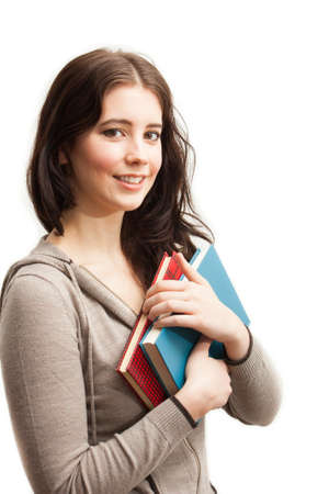 an attractive college student holding books isolated on white Stock Photo