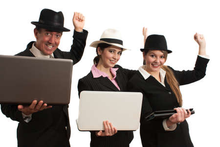 A trio of business people with computers and fedora hats dancing   photo