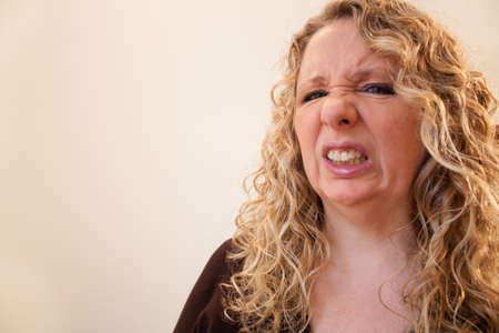 Woman looking into the camera as if she is viewing something unpleasant