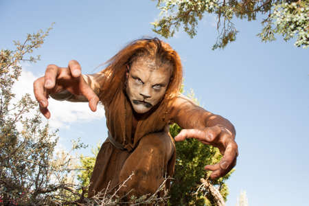 seizing: A human Lion creature reaches out menacingly to grab you   Looking into the camera   Character created by renowned special fx make-up artist Rayce Bird