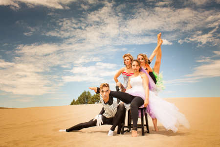 Circus contortionists Troupe pose supporting each other in the desert  photo
