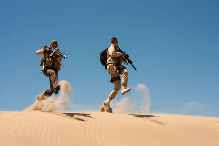 special operations: The Special Operations agents in action, jump and cover in the desert sands.
