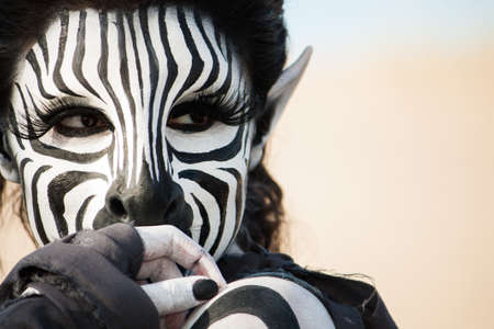 Close up face of a shy quiet Zebra woman.  The intricate special FX make up is the work of Rayce Bird.