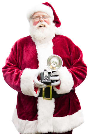 Santa Claus holding a vintage camera laughs, looking into the camera-isolated on white photo