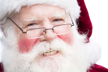 Close up face shot of Santa Claus smiling and wearing glasses