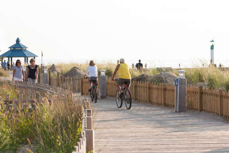 Grand Bend, Ontario, Canada - August 15, 2012  People enjoying healthy activities at the end of a summer day at the Grand Bend Boardwalk on the shores of Lake Huron