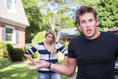 A young man shows frustration in an argument with his girlfriend Stock Photo