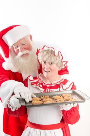 se�ora: Pap� roba una galleta caliente de la bandeja se�ora Claus.