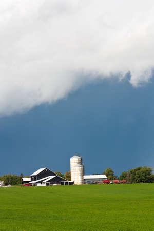 southwestern ontario: A low cloud settles over a beautiful scene of Southwestern Ontario Farmland as a storm brews.