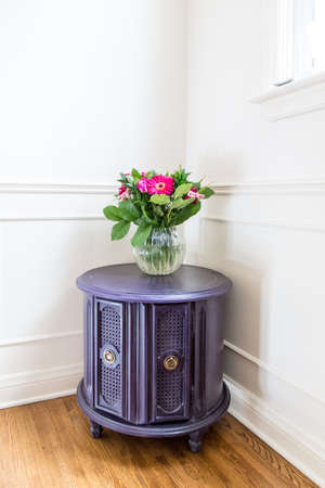 An old drum table gets a stylish new look with a coat of aubergine chalk paint