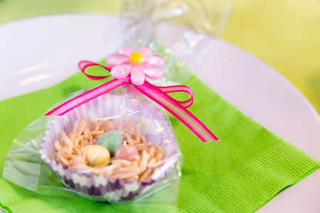 favor: Home made Easter treats formed into a nest and filled with candy coated chocolate eggs for a perfect party favor.