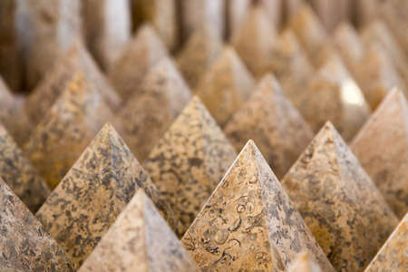 clustered: stone pyramids clustered in a pattern to fill the frame creating an interesting  background Stock Photo