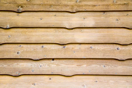 knotty: traditional aged cedar siding used on cottages makes a great wood backdrop Stock Photo