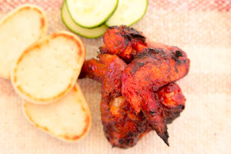 spicy tandoori chicken wings from directly above Stock Photo