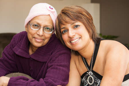 housecoat: a mother and daughter smile with hopefulness after chemo treatments for cancer